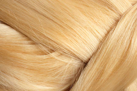 Healthy braided blond hair as background, closeup