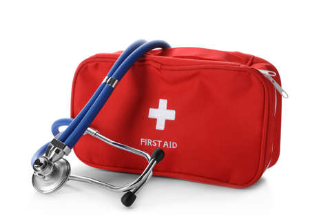 First aid kit with stethoscope on white background Stock Photo