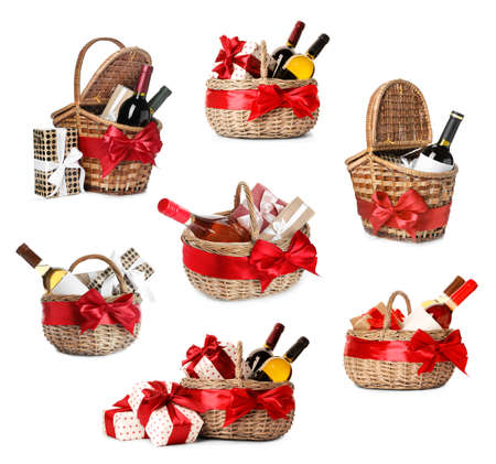 Set with gift baskets and wine on white background 版權商用圖片