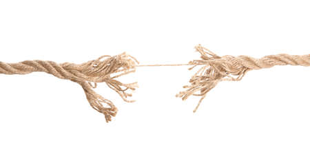 Frayed rope at breaking point on white background Stock Photo