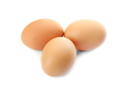 Raw brown chicken eggs on white background