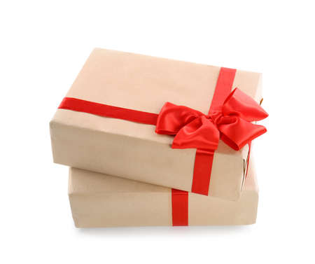 Parcels wrapped in kraft paper with red bow on white background