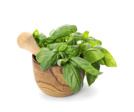 Mortar with fresh green basil leaves on white background