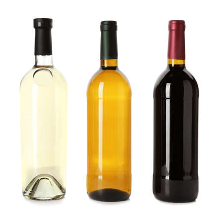Bottle with different types of wine on white background