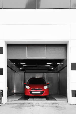 Red auto at car wash. Cleaning service Stock Photo