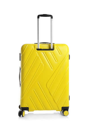 Yellow suitcase for travelling on white background
