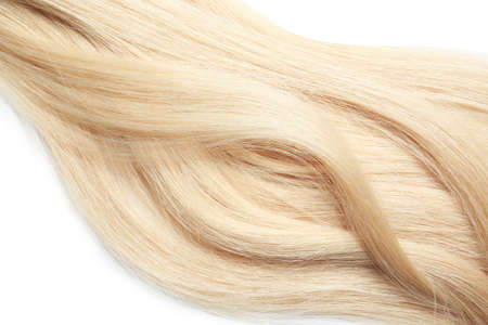 Locks of healthy blond hair on white background