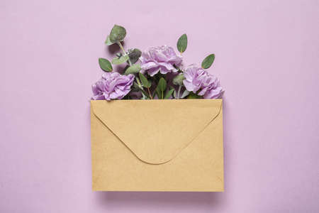 Flat lay composition with beautiful blooming flowers on color background