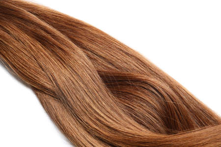 Locks of healthy red hair on white background