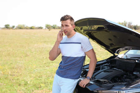 Man talking on phone near broken car outdoors. Space for text Stock fotó