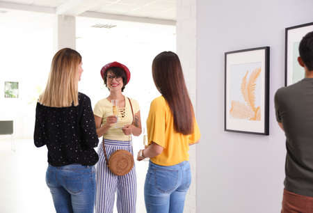 Beautiful women at exhibition in art gallery