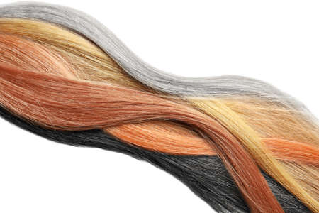 Colorful hair strands on white background, top view