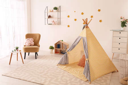 Cozy child's room interior with play tent and toys