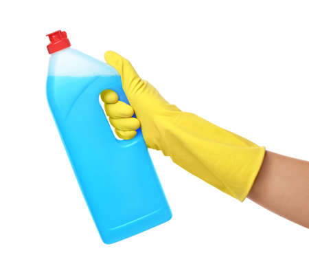 Woman holding bottle of cleaning product for dish washing on white background, closeup
