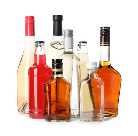 Bottles with different alcoholic drinks on white background 스톡 콘텐츠
