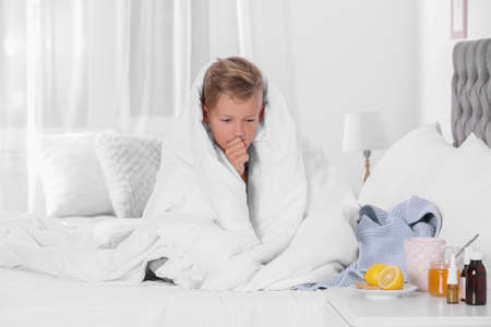 Ill boy suffering from cough at home
