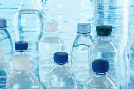 Set of different plastic bottles with pure water, closeup