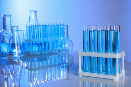 Holder with test tubes for analysis on table in laboratory. space for text