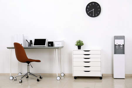 Modern water cooler in stylish office interior