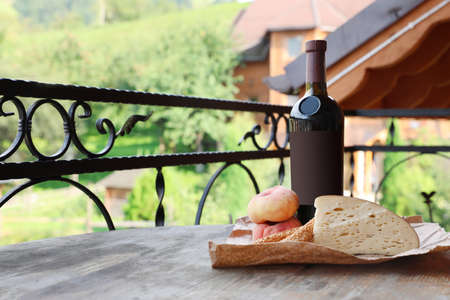 Bottle of wine with cheese and peaches on wooden table. Space for text Banque d'images - 110490709