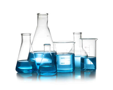 Laboratory glassware with liquid on table against white background.