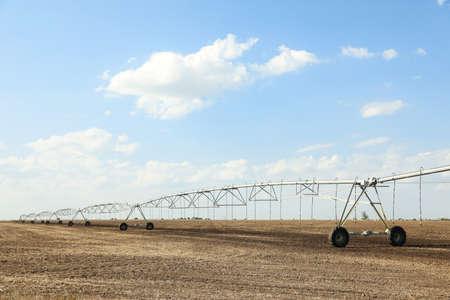 Field with irrigation system on sunny day Stok Fotoğraf