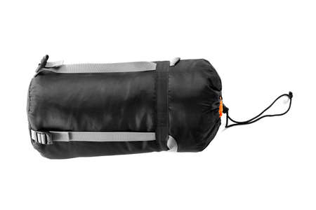 Rolled sleeping bag on white background. Camping equipment