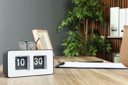 Stylish flip clock on table in office,  space for text. Time management