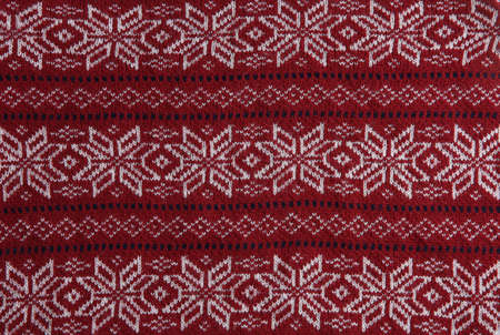 Christmas sweater with pattern as background, top view. Seasonal clothing Stock Photo