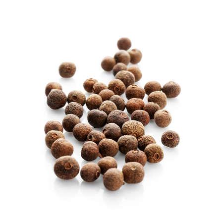 Allspice pepper grains on white background. Natural spice