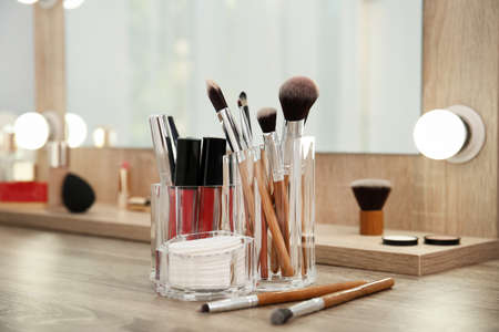 Makeup cosmetic products and tools on dressing table 免版税图像
