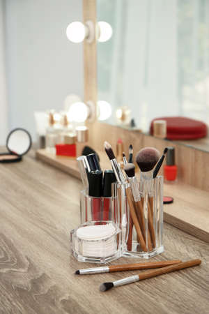 Makeup cosmetic products and tools on dressing table Stock fotó