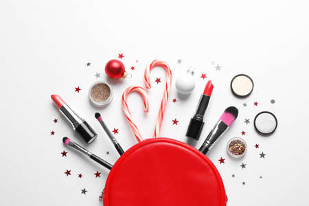 Flat lay composition with makeup products and Christmas decor on white background Standard-Bild - 110810178