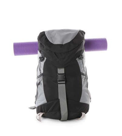 Camping backpack and mat on white background Stock Photo