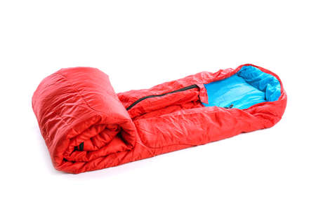 Sleeping bag on white background. Camping equipment Фото со стока