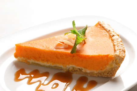 Plate with piece of fresh delicious homemade pumpkin pie on table, closeup Stock Photo