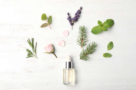 Essential oil and ingredients on wooden background, flat lay 写真素材 - 111060726