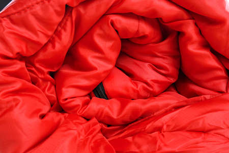 Rolled sleeping bag, closeup view. Camping equipment