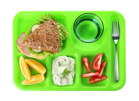 Serving tray with healthy food on white background, top view. School lunch Stock Photo