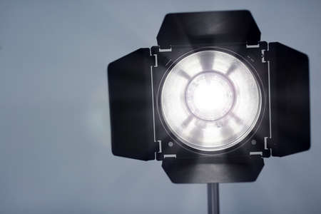 Studio lighting against gray background. Professional photo equipment