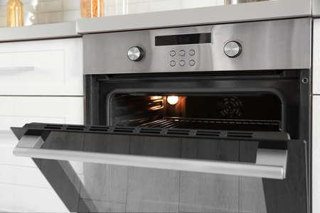 Open modern oven built in kitchen furniture, closeup Reklamní fotografie