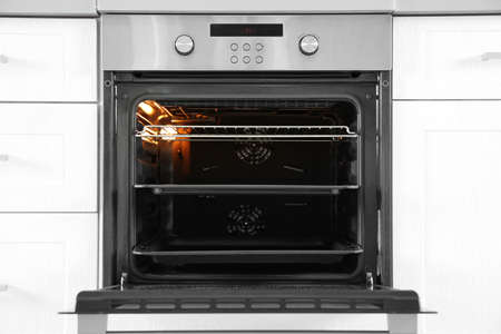 Open modern oven built in kitchen furniture 免版税图像 - 111230598