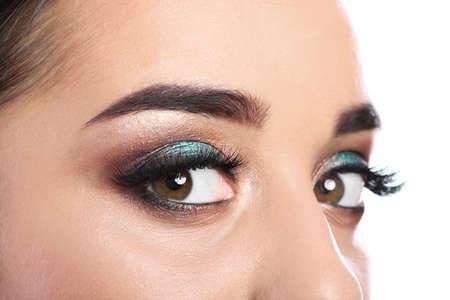 Young woman with eyelash extensions and beautiful makeup, closeup Imagens