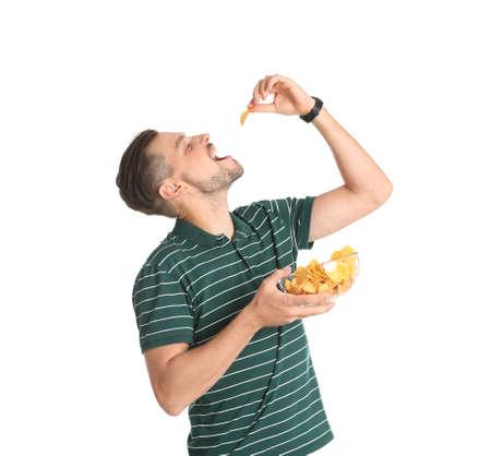 Man eating potato chips on white background Stock Photo