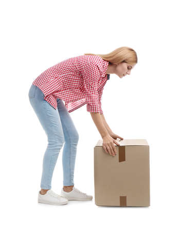 Full length portrait of woman lifting carton box on white background. Posture concept