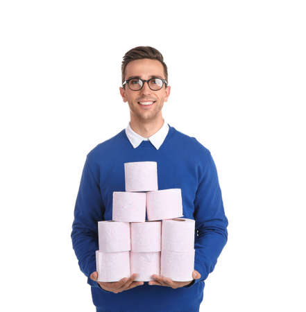 Young man holding toilet paper rolls on white background Stock Photo