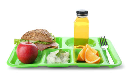 Serving tray with healthy food on white background. School lunch