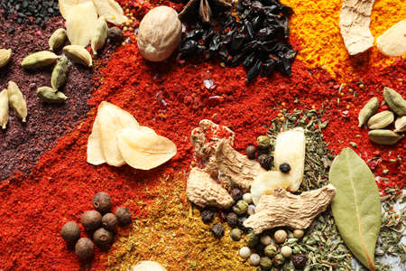 Different aromatic spices as background, top view