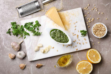 Flat lay composition with homemade basil pesto sauce and ingredients on table Stock Photo