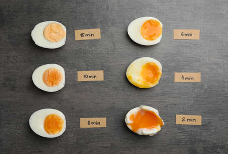 Various types of boiled eggs on grey background, flat lay. Cooking time